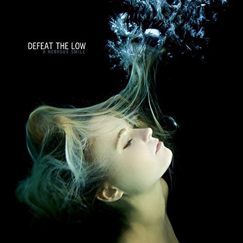 Defeat The Low A Nervous Smile (includes CD Of Full Alb