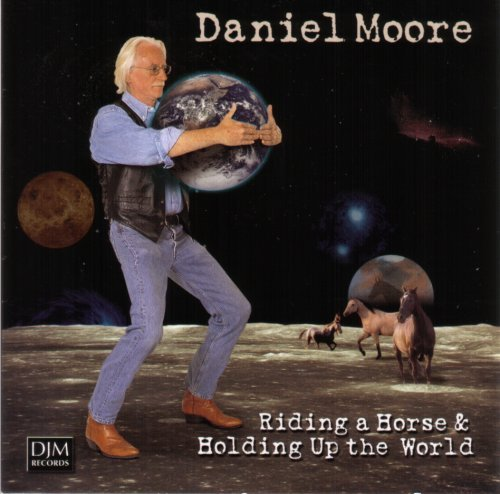 Daniel Moore Riding A Horse & Holding Up Th