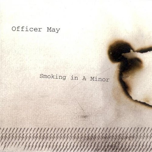Officer May Smoking In A Mirror